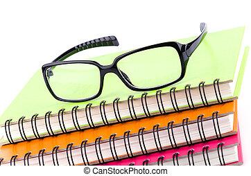 Eye glasses on book