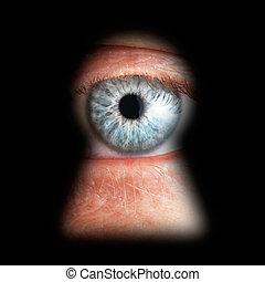 Eye in keyhole, isolated on black background
