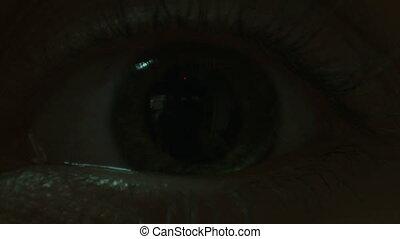 Eye iris contracting - Close-up of eye iris contracting.