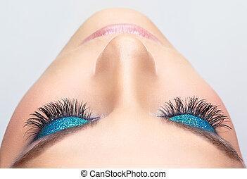 Eye make-up - Woman face with blue shining eye make-up