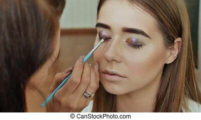 Eye Makeup. Beautiful Eyes Glitter Make-up. Holiday Makeup detail. Eyelids of the eyes.