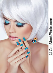 Eye makeup. Manicured nails. Beauty Fashion Blond Woman Portrait with short white hair styling.