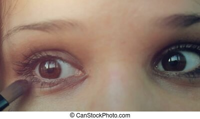 Eye makeup woman applying eyeshadow powder. 4k