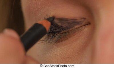Eye makeup woman applying eyeshadow powder, Close up. Slow motion