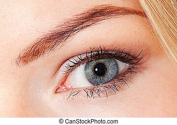 eye of beautiful young woman in studio
