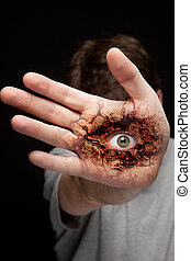 Eye on human hand - vision and identity concept