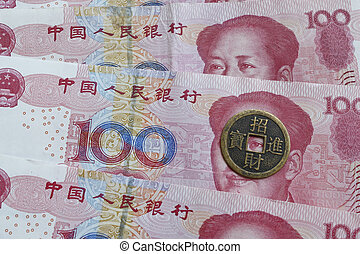 chairman mao looks through the eye of an old chinese coin