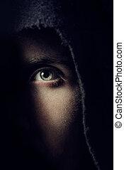 Eye of man in hole