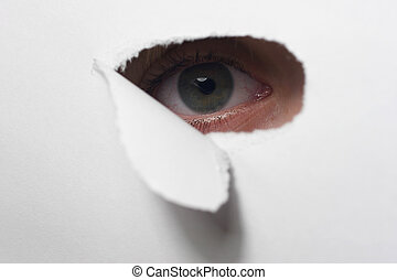 Eye - A childlike eye examined with a paper hole through it.