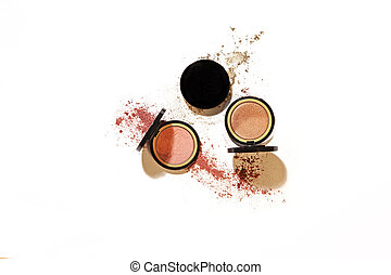Eye shadow colour pallettes make up kit in a set on white background with harsh hi-key lighting and shadows