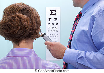 Eye test - Photo of a woman at the opticians having her...