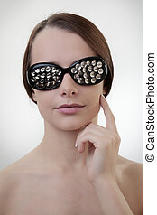 sexy woman wearing glasses made up from drawing pin