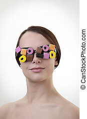 eye wear - sexy woman wearing glasses made up from sweets