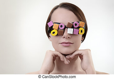 sexy woman wearing glasses made up from sweets