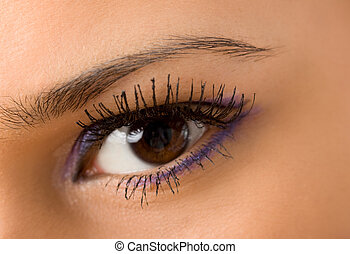 eye with long eyelashes - female wide open brown eye with...