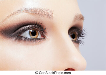 close-up portrait of beautiful young woman's eye zone makeup