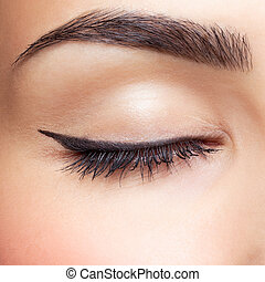 eye zone makeup - close-up portrait of young beautiful...