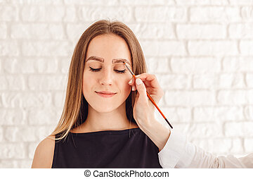Eyebrow correction procedure for the smiling model with long eyelashes