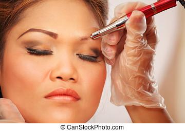 Eyebrow makeup - Makeup eyebrow tattoo, young asian woman...