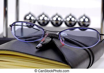 Eyeglasses and Journal