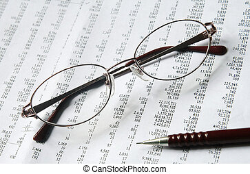 eyeglasses and pencil on document