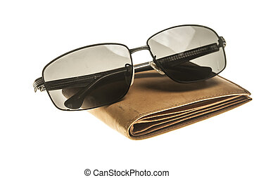 Eyeglasses and wallet isolated on white background