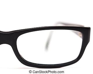 Eyeglasses - Detail of black eyeglasses on a white ...