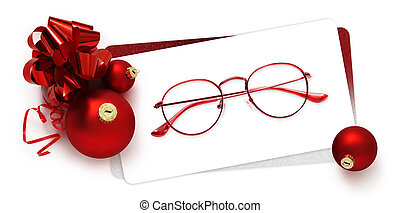 eyeglasses gift card, red spectacles and red christmas balls with ribbon bow, isolated on white background