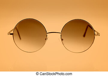 Eyeglasses on brown background