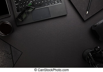 Eyeglasses On Laptop With Office Supplies At Gray Desk