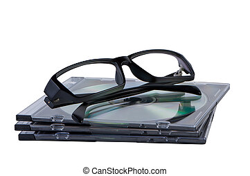Eyeglasses on stack of CD DVD discs isolated.