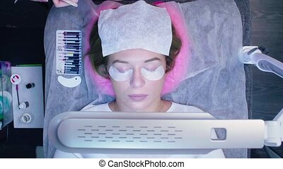 Eyelash extension procedure in a beauty salon - Top view....