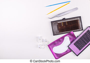 Eyelash Extension tools on white background. Accessories for eyelash extensions. Artificial lashes. Top view.