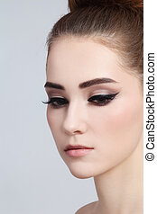 Portrait of young beautiful girl with cat eye make-up