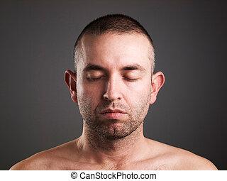 Eyes man closed on dark background