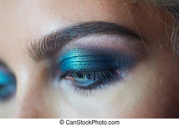 eyes of a beautiful woman with evening make-up