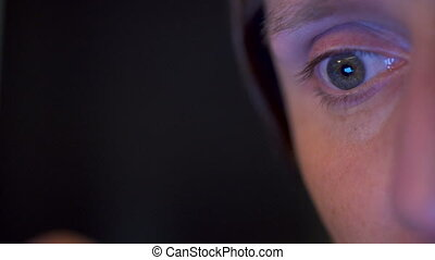 Eyes of a man focused on working with computer in the office