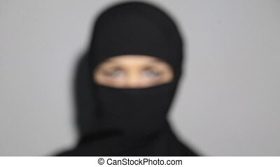 Eyes of arab woman with veil over face