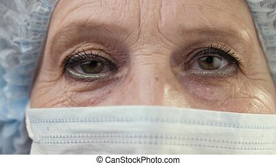 Eyes of female doctor in face mask