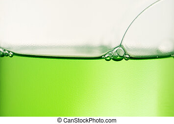 Eyes of green liquid frog - Drops at the green luquid border...