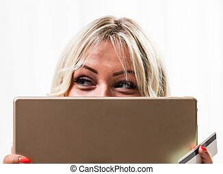 Eyes of woman with tablet and credit card