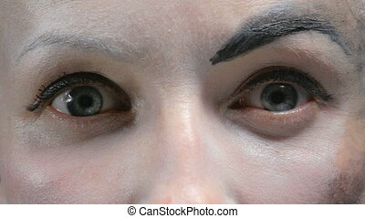 Eyes of woman with white make up