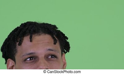 Eyes of young African man with dreadlocks thinking