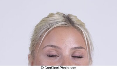 Eyes of young beautiful blonde woman thinking - Studio shot...