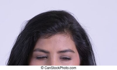 Eyes of young Persian woman thinking and looking up - Studio...