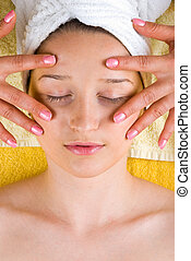 Eyes skin facial massage - Woman getting a skin eyes facial...