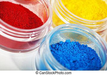 Eyeshadow Pots - Macro of brilliantly hued pots of loose...