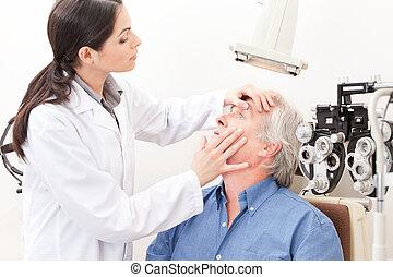 Eyesight Test Examination - Optometrist taking an eyesight ...