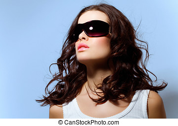 Eyewear - Beauty shot of a woman in large shades.