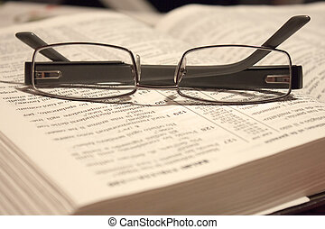 eyewear on a Bible - a pair of eyewear resting on a Bible